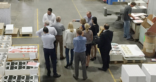 People discussing project at the warehouse