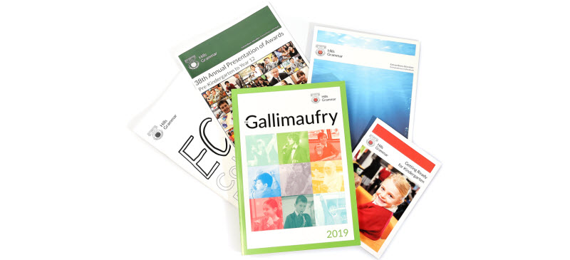 Different yearbooks and school administration books
