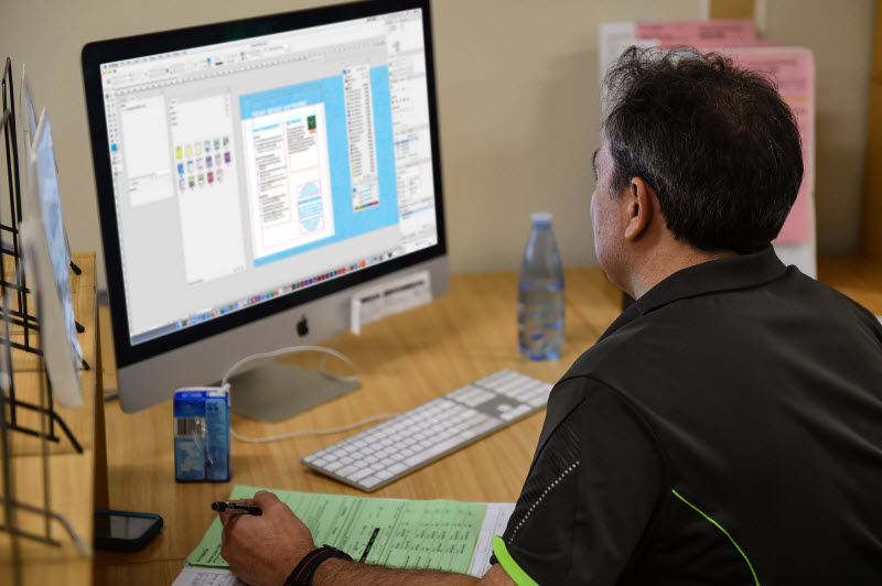 Man working on designing using a desktop