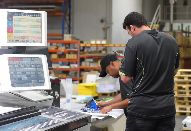 Men working at printing factory