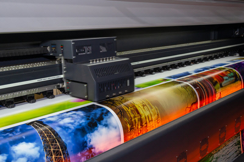 Large format printing machine in operation