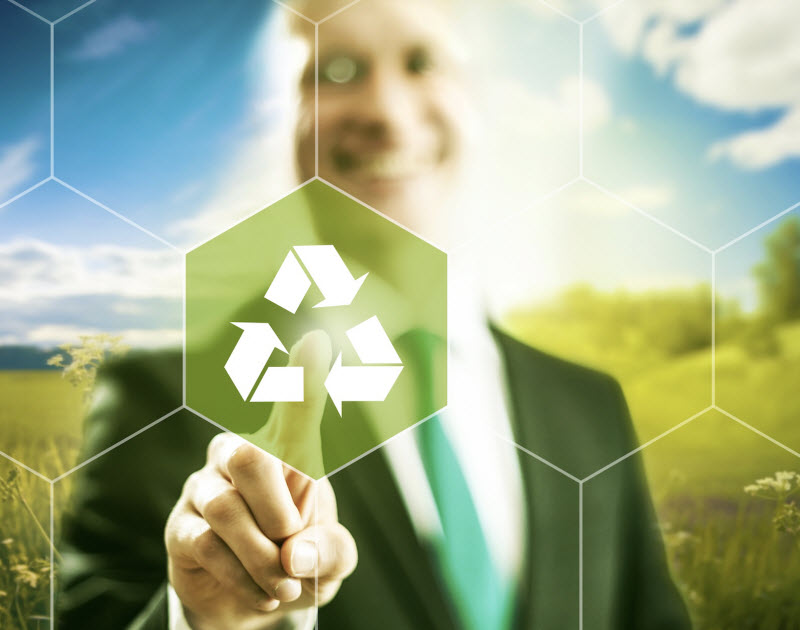 Man on a field with a recycle icon